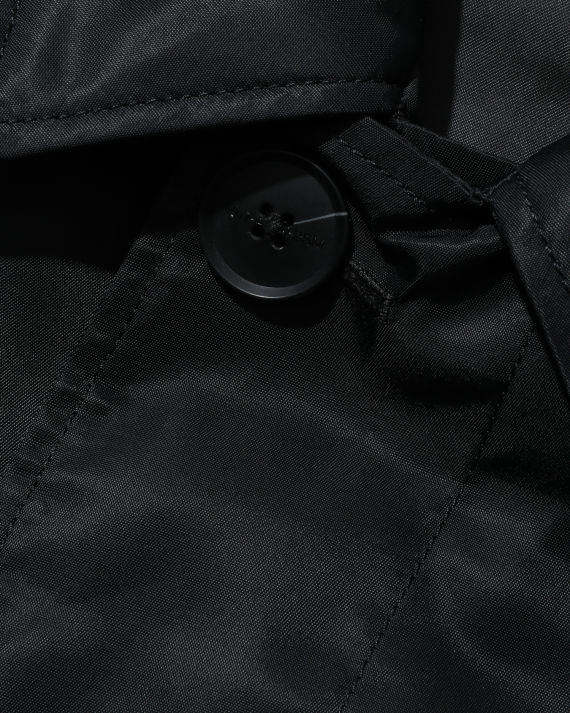 Ron Wan with 1017 ALYX 9SM black trench coat online only at I.T eSHOP.